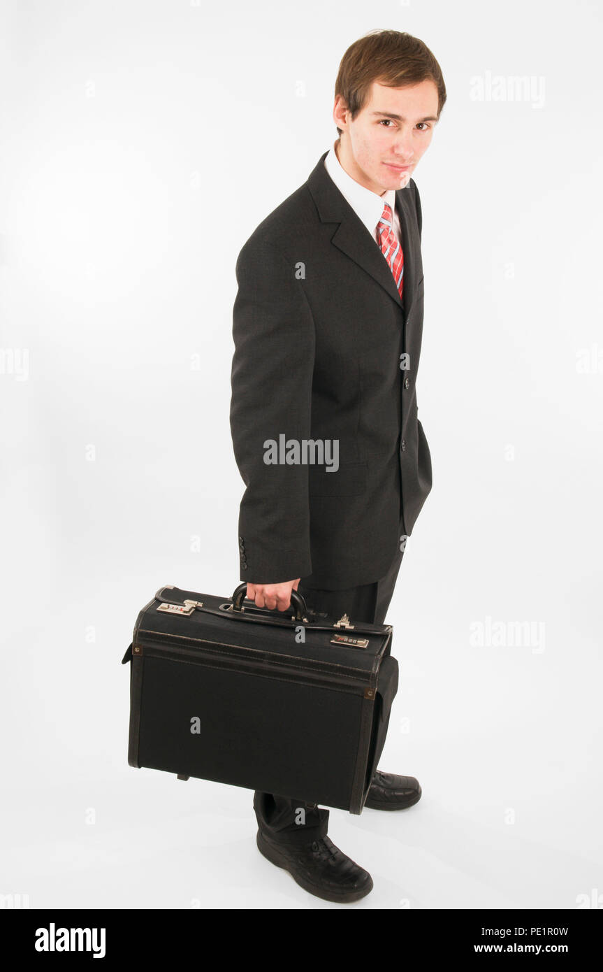 Side Full Body View Of A Man In Black Suit Pants And Black Shoes