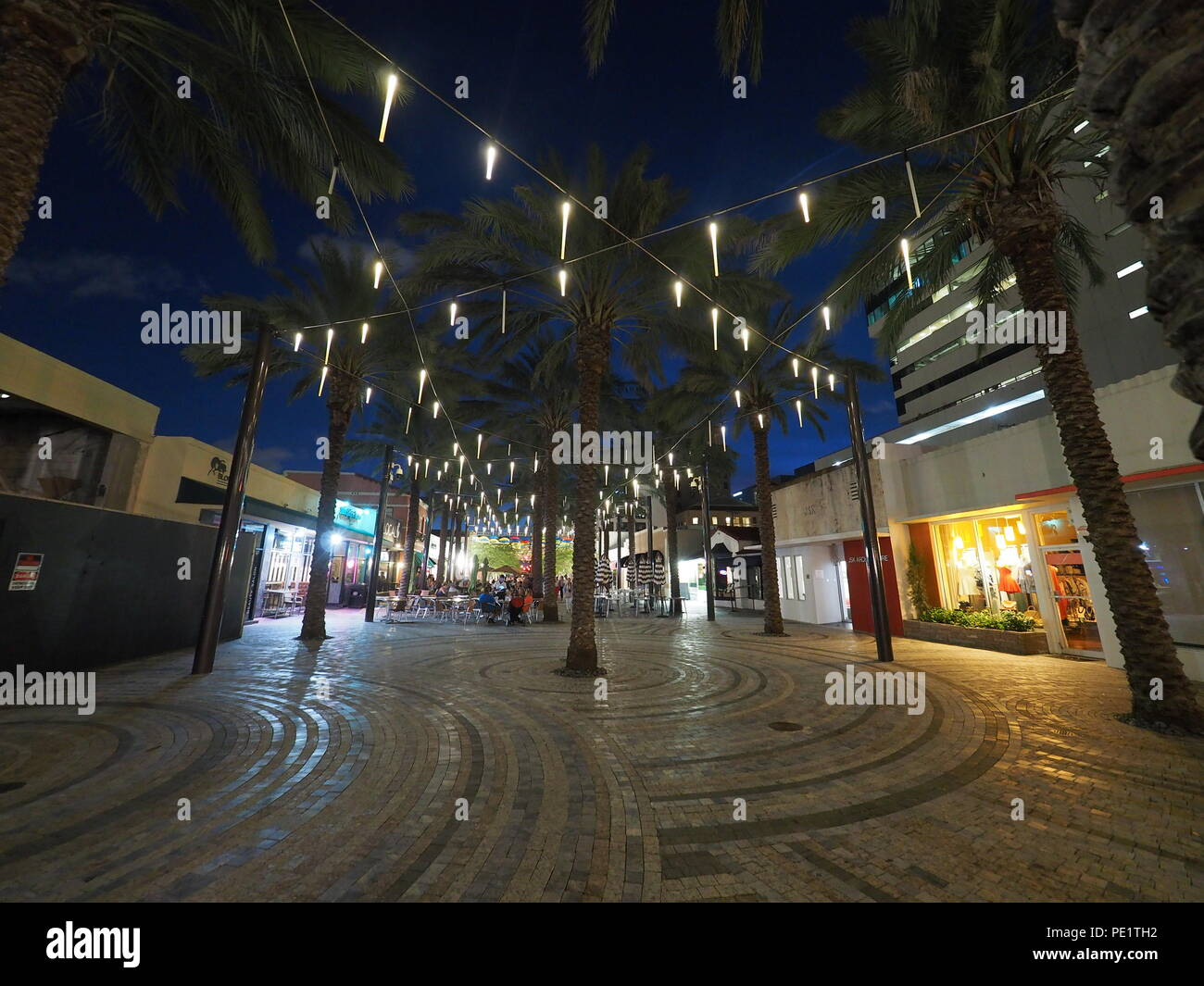 Giralda  Plaza and its restaurants and bars in Coral Gables, Florida, at night, enjoying heavy visitation during the Umbrella Sky project. Stock Photo