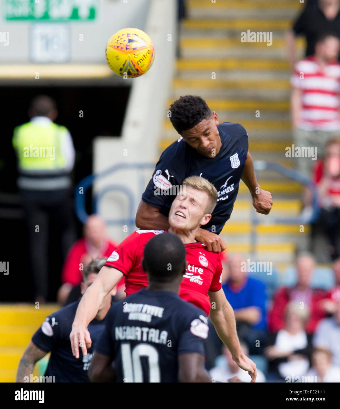 Dens Park, Dundee, UK. 11th Aug, 2018. Ladbrokes Premiership football, Dundee versus Aberdeen; Nathan Ralph of Dundee competes in the air with Sam Cosgrove of Aberdeen Credit: Action Plus Sports/Alamy Live News - Stock Image