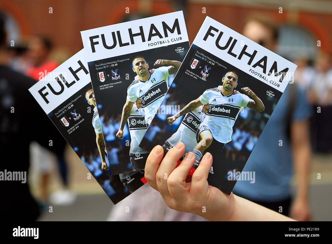 London, UK, 11 Aug 2018. Fulham match day programmes  on sale outside the ground. Premier League match, Fulham v Crystal Palace at Craven Cottage in London on Saturday 11th August 2018.  this image may only be used for Editorial purposes. Editorial use only, license required for commercial use. No use in betting, games or a single club/league/player publications. pic by Steffan Bowen/Andrew Orchard sports photography/Alamy Live news - Stock Image