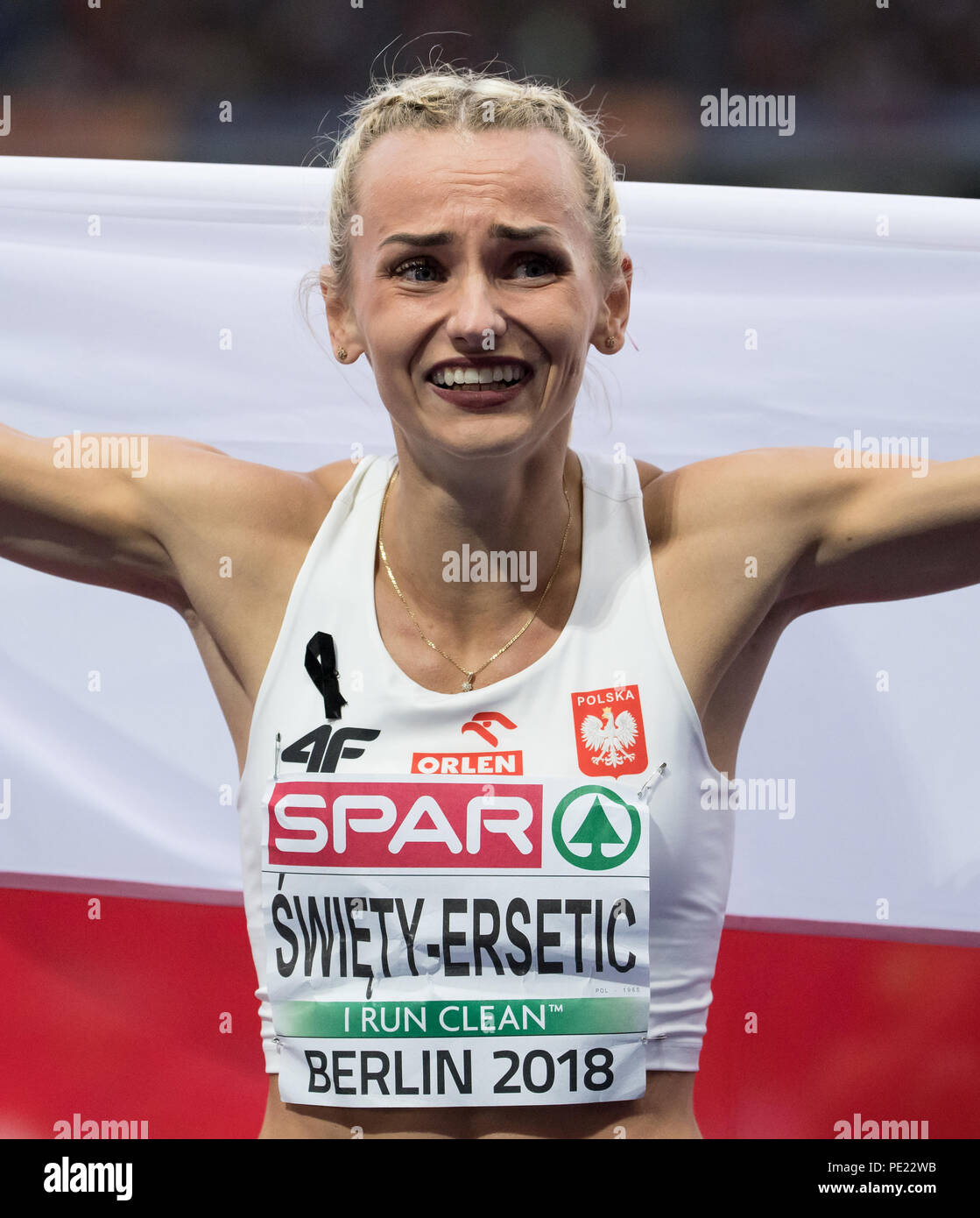 Berlin, Germany. 11th Aug, 2018. European Athletics Championships in the Olympic Stadium: 400 m final, women: Gold medal winner Justyna Swiety-Ersetic from Poland celebrates at the finish line. Credit: Sven Hoppe/dpa/Alamy Live News - Stock Image