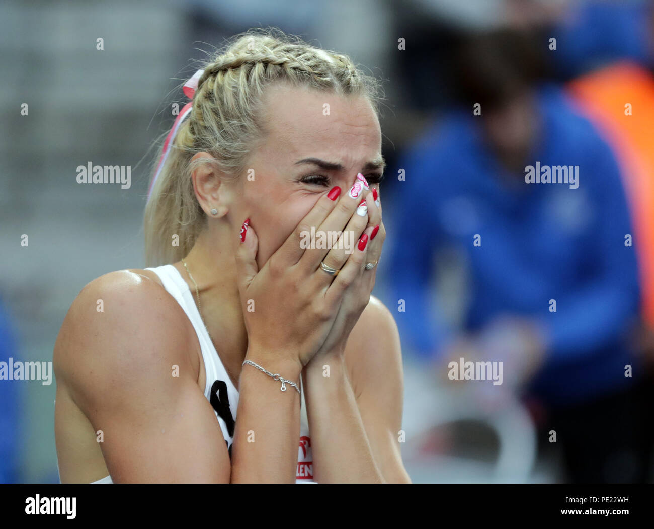 Berlin, Germany. 11th Aug, 2018. European Athletics Championships in the Olympic Stadium: 400 m finals, women: Gold medallist Justyna Swiety-Ersetic from Poland celebrates at the finish line. Credit: Kay Nietfeld/dpa/Alamy Live News - Stock Image