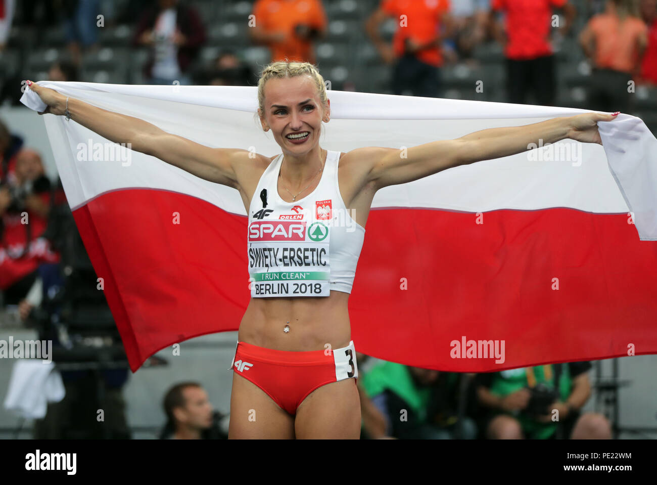 Berlin, Germany. 11th Aug, 2018. European Athletics Championships in the Olympic Stadium: 400 m finals, women: Gold medallist Justyna Swiety-Ersetic from Poland celebrates. Credit: Kay Nietfeld/dpa/Alamy Live News - Stock Image