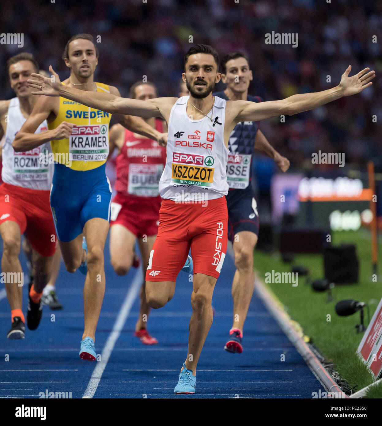 Berlin, Germany. 11th Aug, 2018. European Athletics Championships in the Olympic Stadium: 800 m finals, Men: Gold medallist Adam Kszczot from Poland cheers at the finish line. Credit: Sven Hoppe/dpa/Alamy Live News - Stock Image