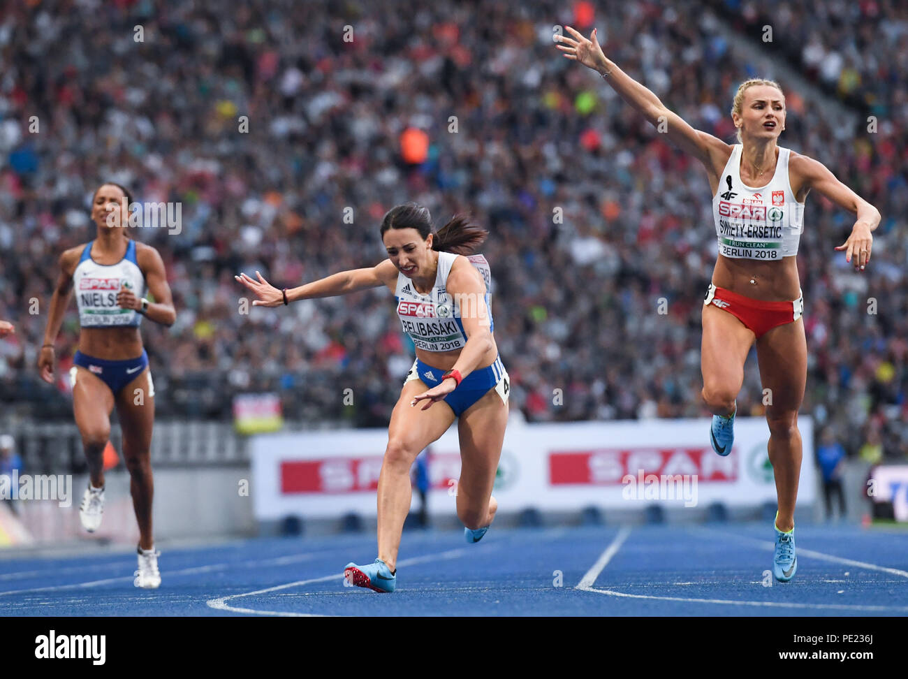 Berlin, Germany. 11th Aug, 2018. European Athletics Championships in the Olympic Stadium: 400 m final, women: (L-R) Laviai Nielsen from Great Britain, Maria Belibasaki from Greece and Justyna Swiety-Ersetic from Poland in action. Credit: Sven Hoppe/dpa/Alamy Live News - Stock Image