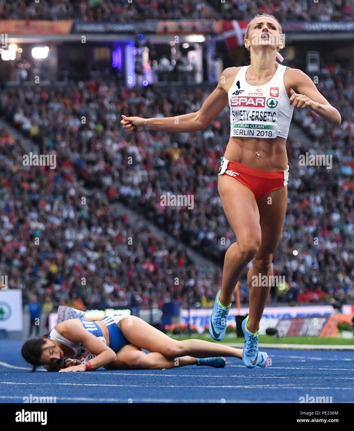 Berlin, Germany. 11th Aug, 2018. European Athletics Championships in the Olympic Stadium: 400 m finals, women: Maria Belibasaki from Greece and Justyna Swiety-Ersetic from Poland in action. Credit: Sven Hoppe/dpa/Alamy Live News - Stock Image