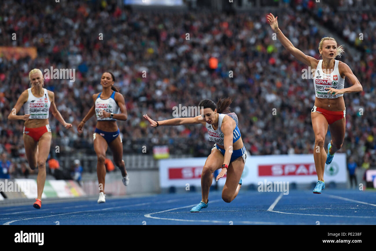 Berlin, Germany. 11th Aug, 2018. European Athletics Championships in the Olympic Stadium: 400 m final, women: (L-R) Iga Baumgart-Witan from Poland, Laviai Nielsen from Great Britain, Maria Belibasaki from Greece and Justyna Swiety-Ersetic from Poland in action. Credit: Sven Hoppe/dpa/Alamy Live News - Stock Image
