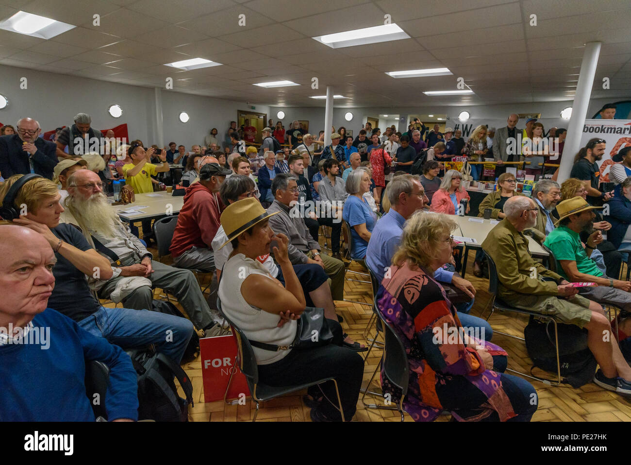 London, UK. 11th August 2018. 11th August 2018. The basement of a nearby church begins to fill up as several hundred people from all parts of the labour movement come to show solidarity and support the Bookmarks socialist bookshop a week after a group of Nazi thugs from 'Make Britain Great Again' invaded the shop in central London, shouting racist slogans and wrecking book displays. Credit: ZUMA Press, Inc./Alamy Live News - Stock Image
