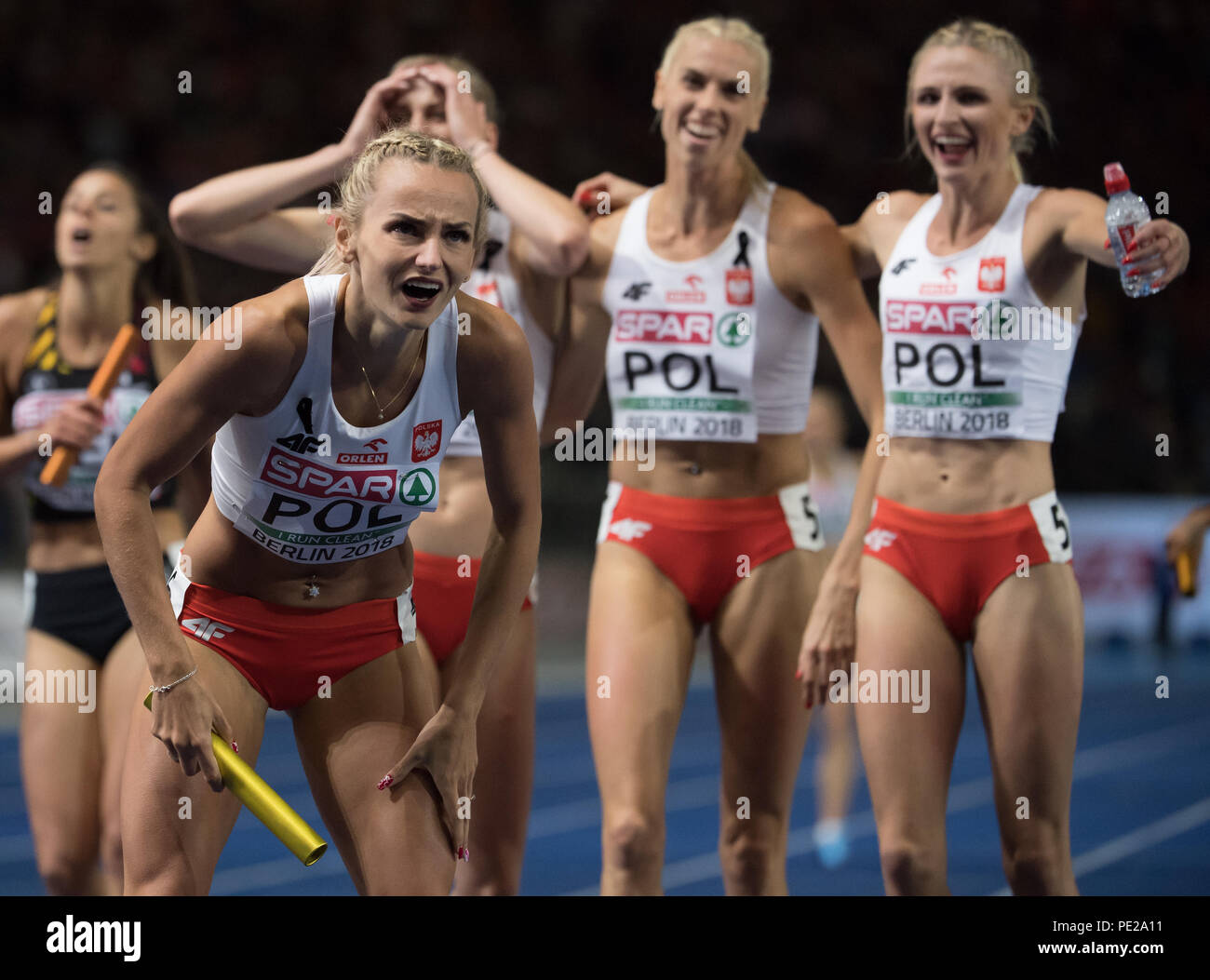 Berlin, Germany. 11th Aug, 2018. Track and Field, European Championship in the Olympic Stadium, 4x400 m Relay Final, Women: Justyna Swiety-Ersetic (l) from Poland cheers at the finish line. Credit: Sven Hoppe/dpa/Alamy Live News - Stock Image