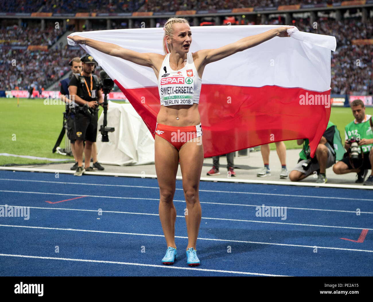 Berlin, Germany. 11th Aug, 2018. Athletics, European Championship in the Olympic Stadium, 400 m final, women: Justyna Swiety-Ersetic from Poland cheers at the finish line. Credit: Sven Hoppe/dpa/Alamy Live News - Stock Image