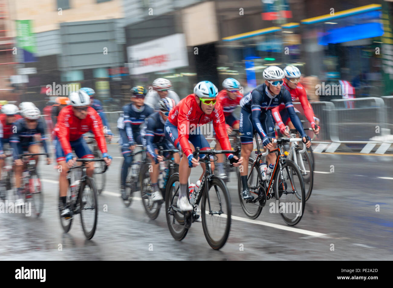 Glasgow, Scotland, UK. 12th August, 2018. The peloton travels down High Street during the Men's Cycling Road Race  covering 16 laps and 230 km through the streets of the city on day eleven of the European Championships Glasgow 2018. Credit: Skully/Alamy Live News - Stock Image