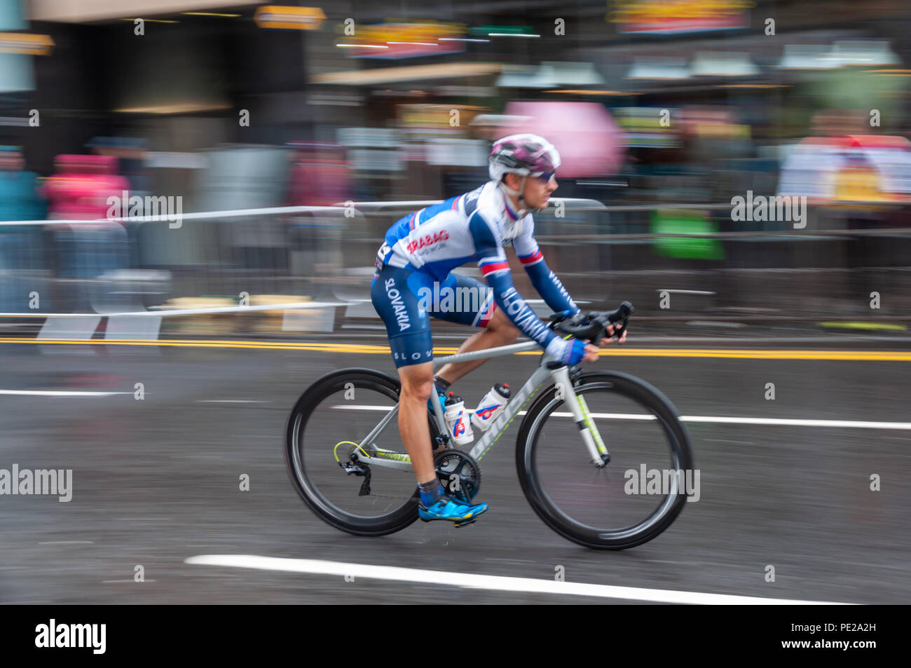 Glasgow, Scotland, UK. 12th August, 2018. A cyclist travels down High Street during the Men's Cycling Road Race covering 16 laps and 230 km through the streets of the city on day eleven of the European Championships Glasgow 2018. Credit: Skully/Alamy Live News - Stock Image