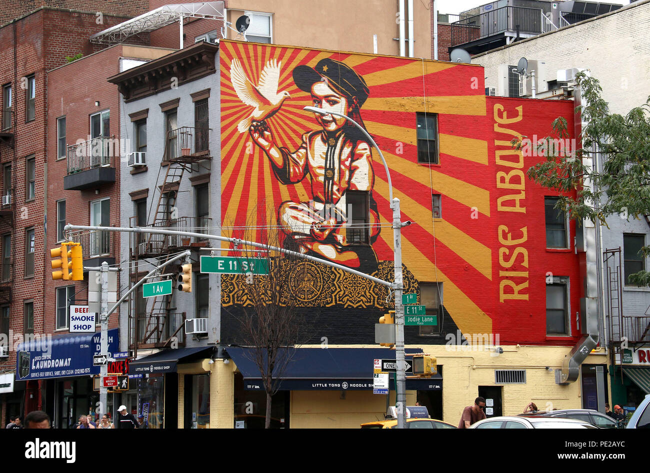 New York City, New York, USA. 12th Aug, 2018. A view of the 'Rise Above' mural by artist SHEPARD FAIREY located on East 11th Street and 1st Avenue in the East Village. The model was his eldest daughter at the age of 3 years. The artist is best known for his Obama 'Hope' poster. The project is meant to be uplifting and make kids and New Yorkers hopeful and happy. Credit: Nancy Kaszerman/ZUMA Wire/Alamy Live News Stock Photo