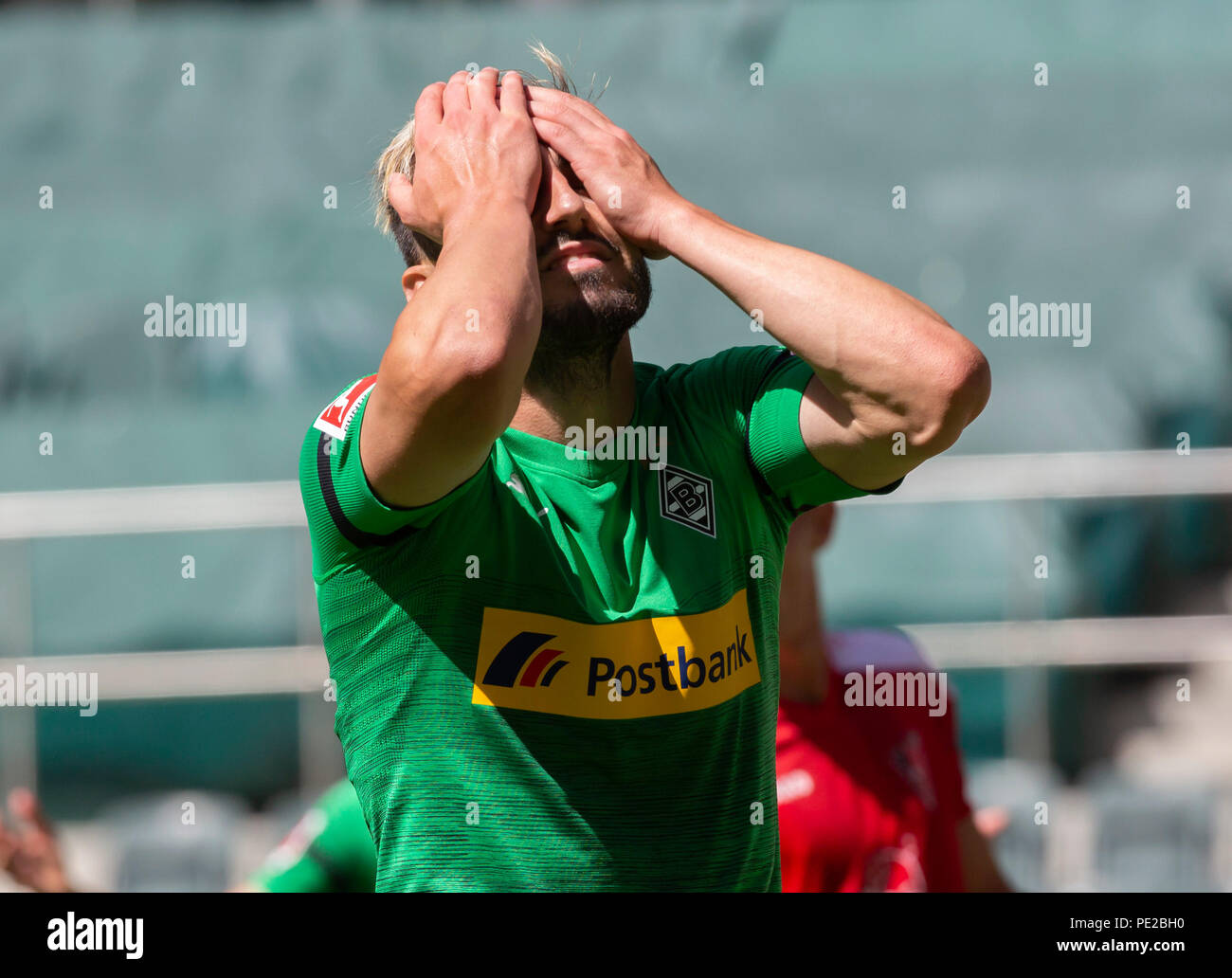 Moenchengladbach, Germany August 12 2018, friendly match, Borussia Moenchengladbach vs FC Wegberg-Beeck: Josip Drmic (BMG) niedergeschlagen.                Credit: Juergen Schwarz/Alamy Live News - Stock Image