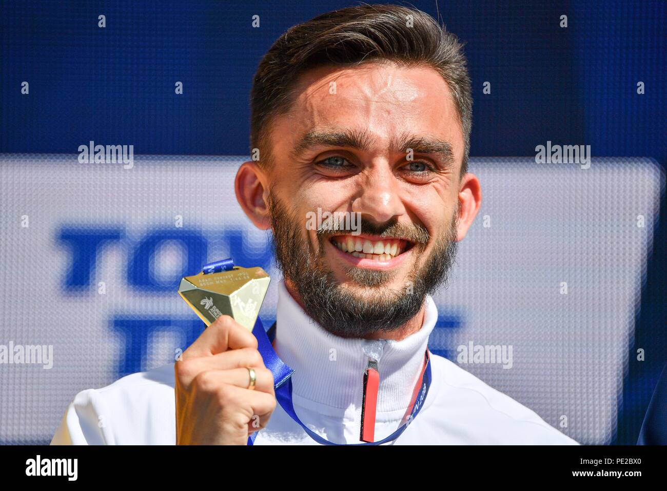 Berlin, Germany. 12th Aug, 2018. Athletics, European Championship, award ceremony on the European Mile at Breitscheidplatz, 800 meters, Men. Gold medal winner Adam Kszczot from Poland. Credit: Bernd Thissen/dpa/Alamy Live News - Stock Image