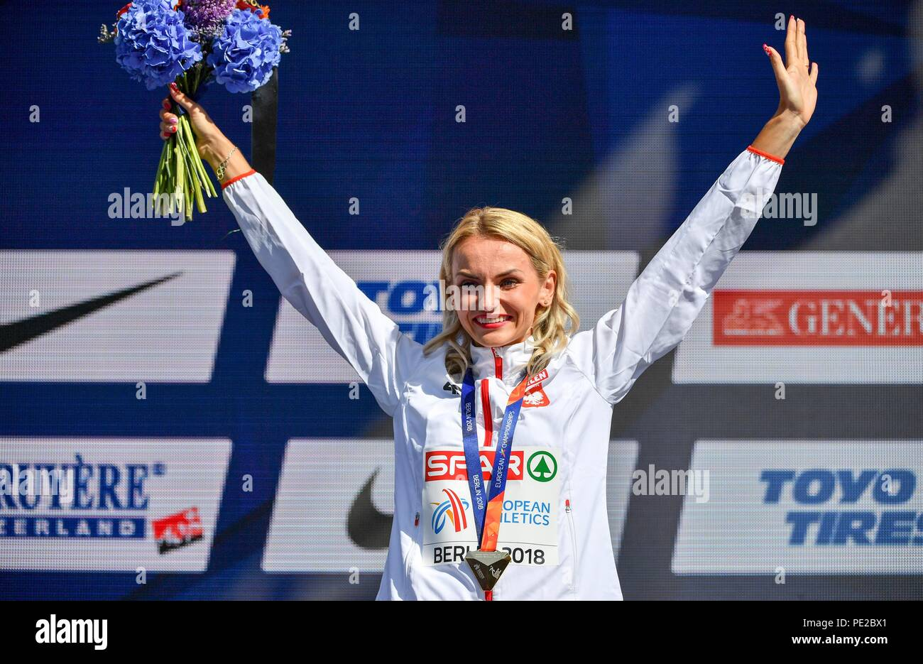 Berlin, Germany. 12th Aug, 2018. 12.08.2018, Berlin: Track and Field, European Championship, Award Ceremony on the European Mile at Breitscheidplatz: 400 meters, Women: Gold medal winner Justyna Swiety-Ersetic from Poland. Credit: Bernd Thissen/dpa/Alamy Live News - Stock Image