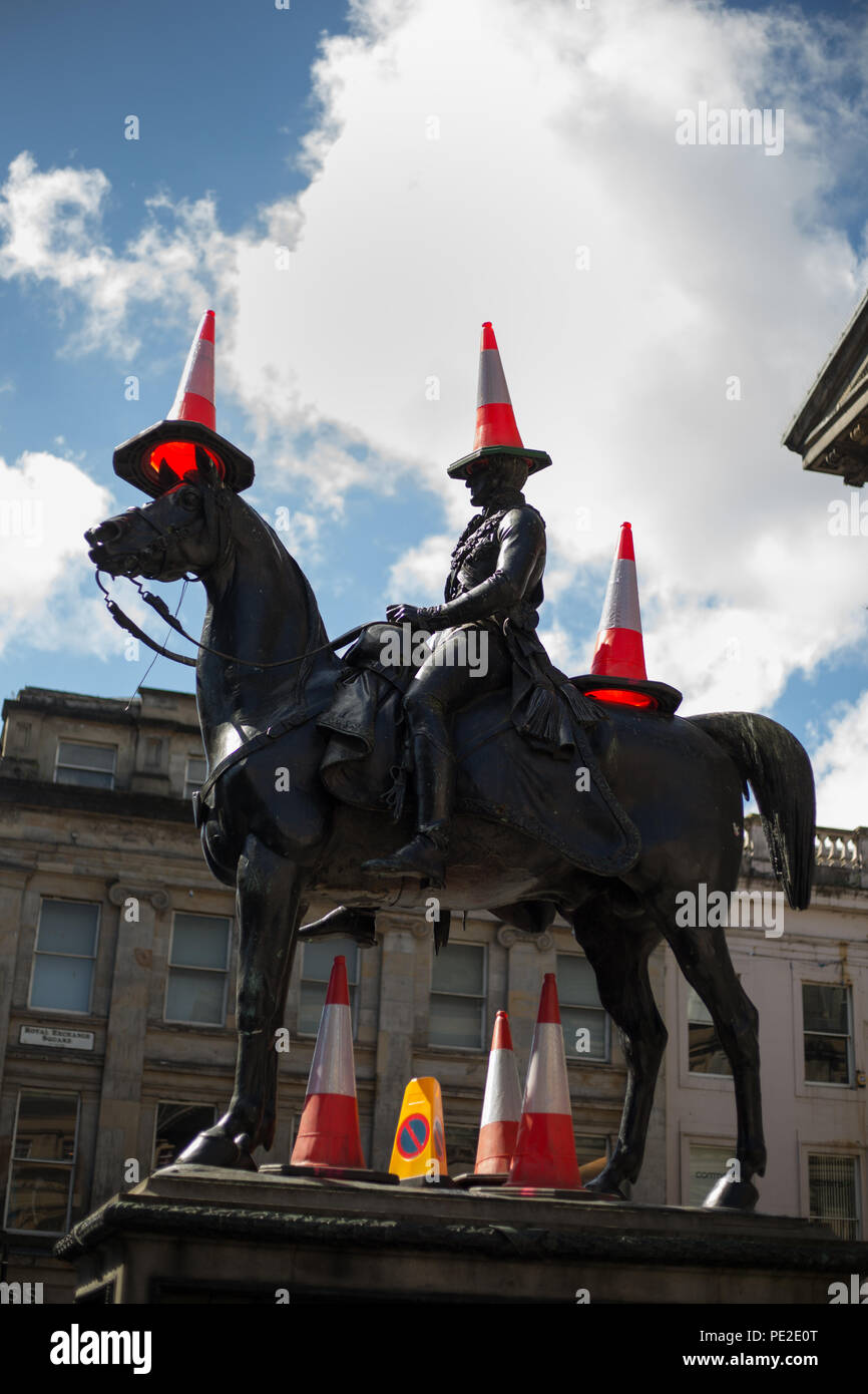 Iconic statue of Duke of Wellington, with police traffic cones on his head ( a modern Glasgow tradition), in Glasgow, Scotland, on 9 August 2018. - Stock Image