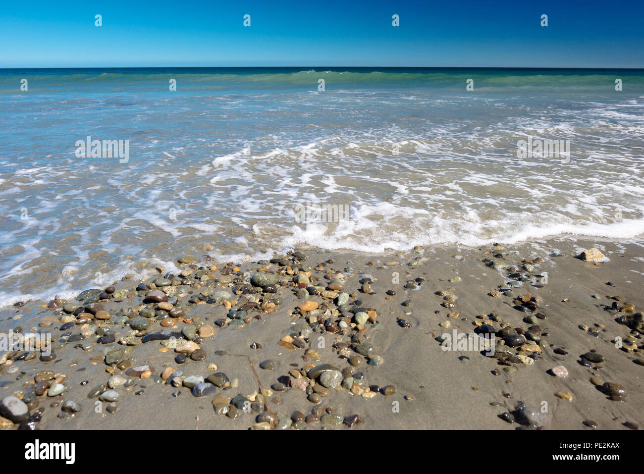 Jungle Beach on a clear summer day in Haida Gwaii, British Columbia, Canada - Stock Image