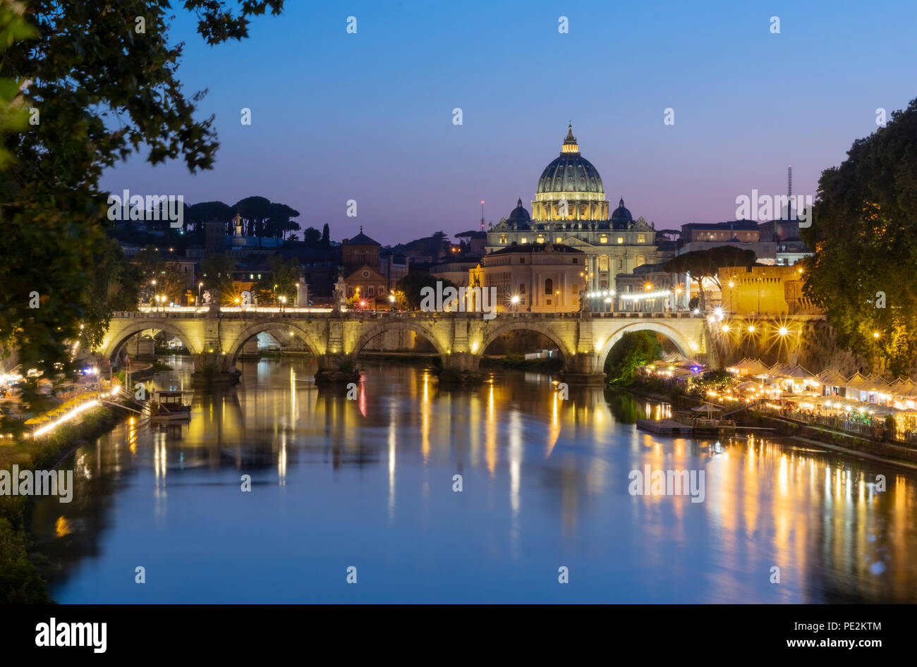 Rome at night. View over Tiber river on Vatican and dome of St. Peter's Basilica - Stock Image