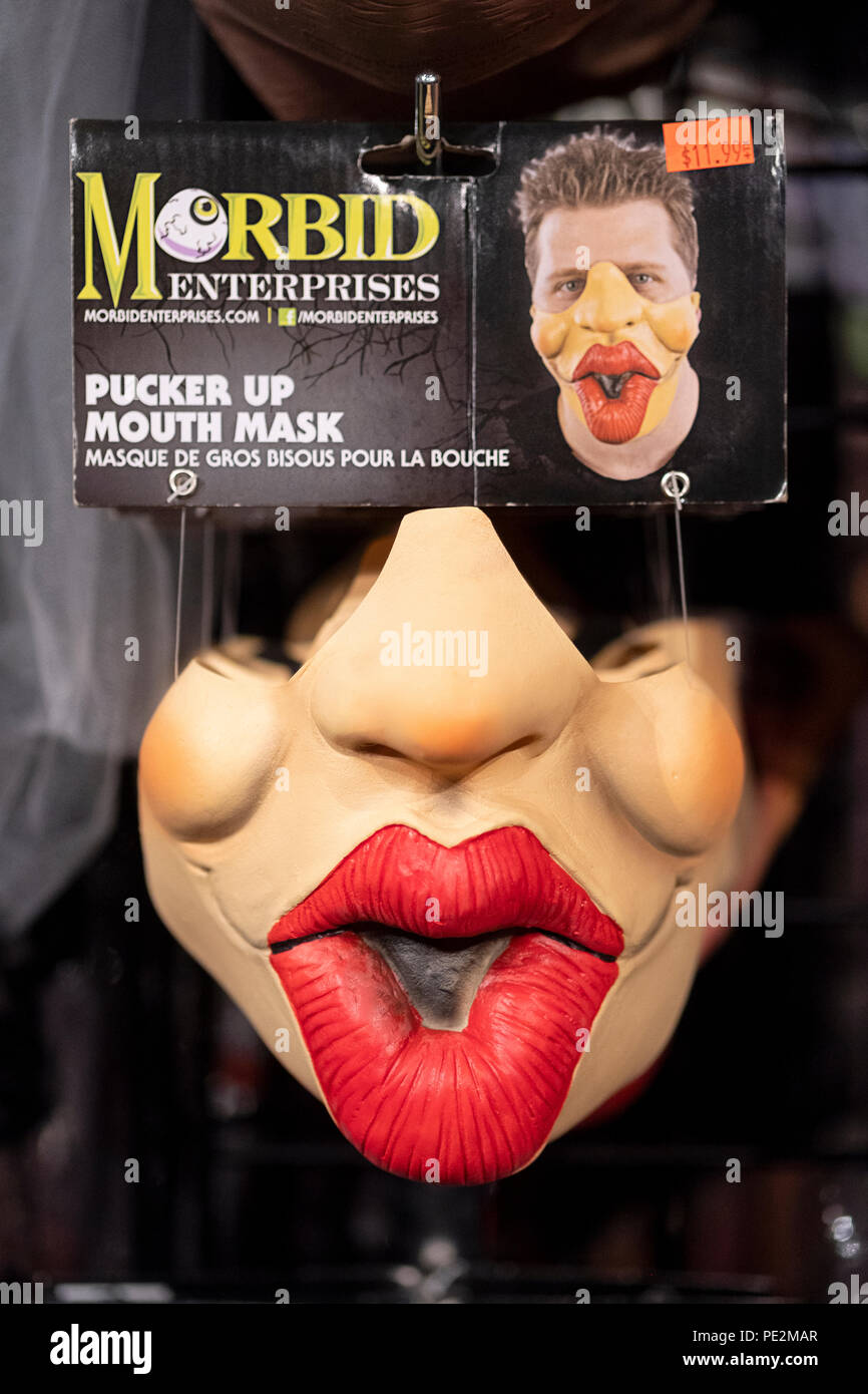 Outrageous unusual half-face masks for sale at a costume store in Greenwich Village, Manhattan, New York City. - Stock Image