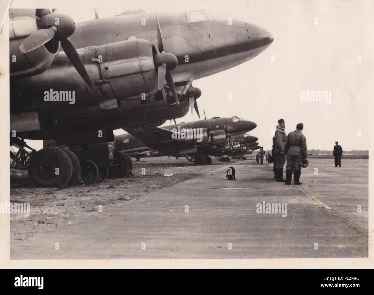 Image from the photo album of Oberfeldwebel Karl Gendner of 1. Staffel, Kampfgeschwader 40: Line up of Focke Wulf FW 200 Condor aircraft of 1. Staffel, KG 40 at Bordeaux on 28th June 1941. The censor has removed the KG 40 emblems on the front of the aircraft. - Stock Image