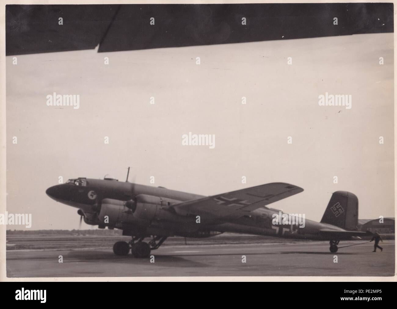 Image from the photo album of Oberfeldwebel Karl Gendner of 1. Staffel, Kampfgeschwader 40: Focke Wulf Fw 200 Condor F8+CL of 3./KG 40, running up its engines at Bordeaux in March 1941. - Stock Image