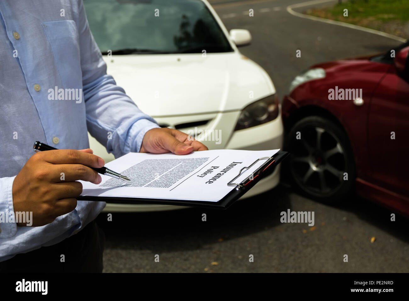 The insurance agent examining car after accident on the road. Insurance claim concept . - Stock Image