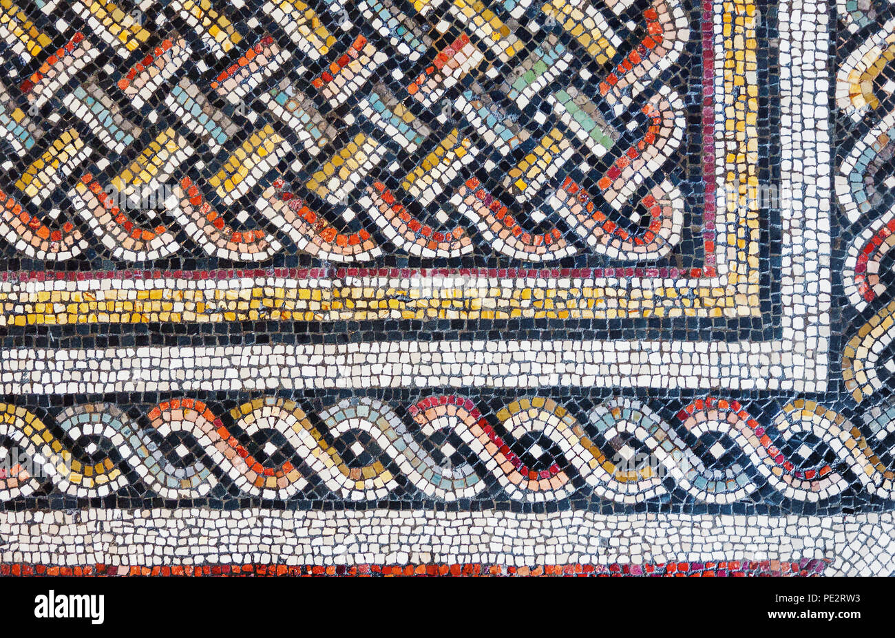 Colorful small tiles of an ancient floor mosaic, geometric ornament background Stock Photo