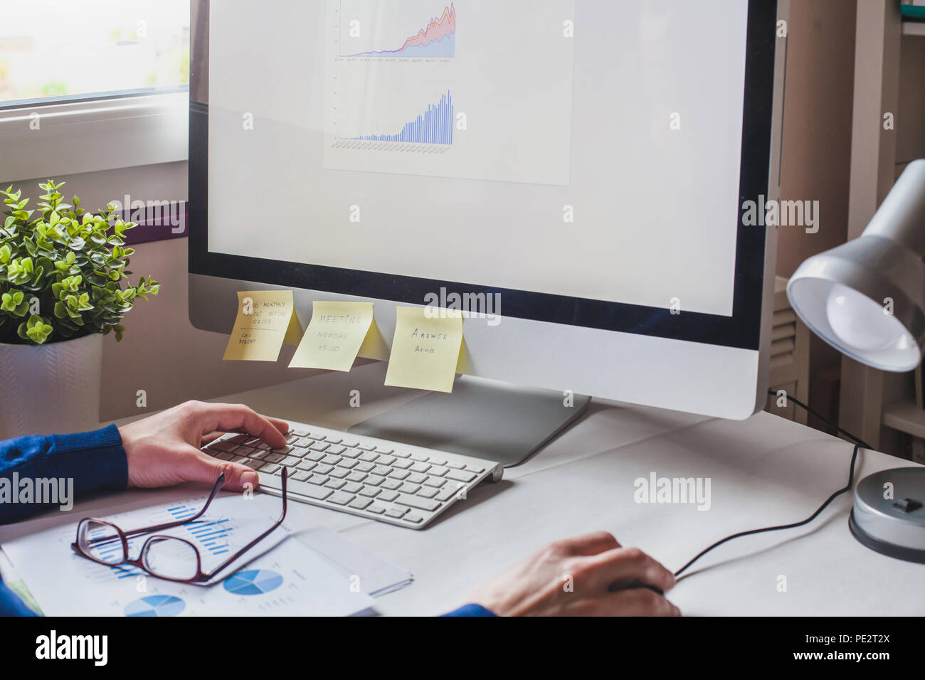 business man analyzing financial report on screen of computer, finance analytics of company performance Stock Photo