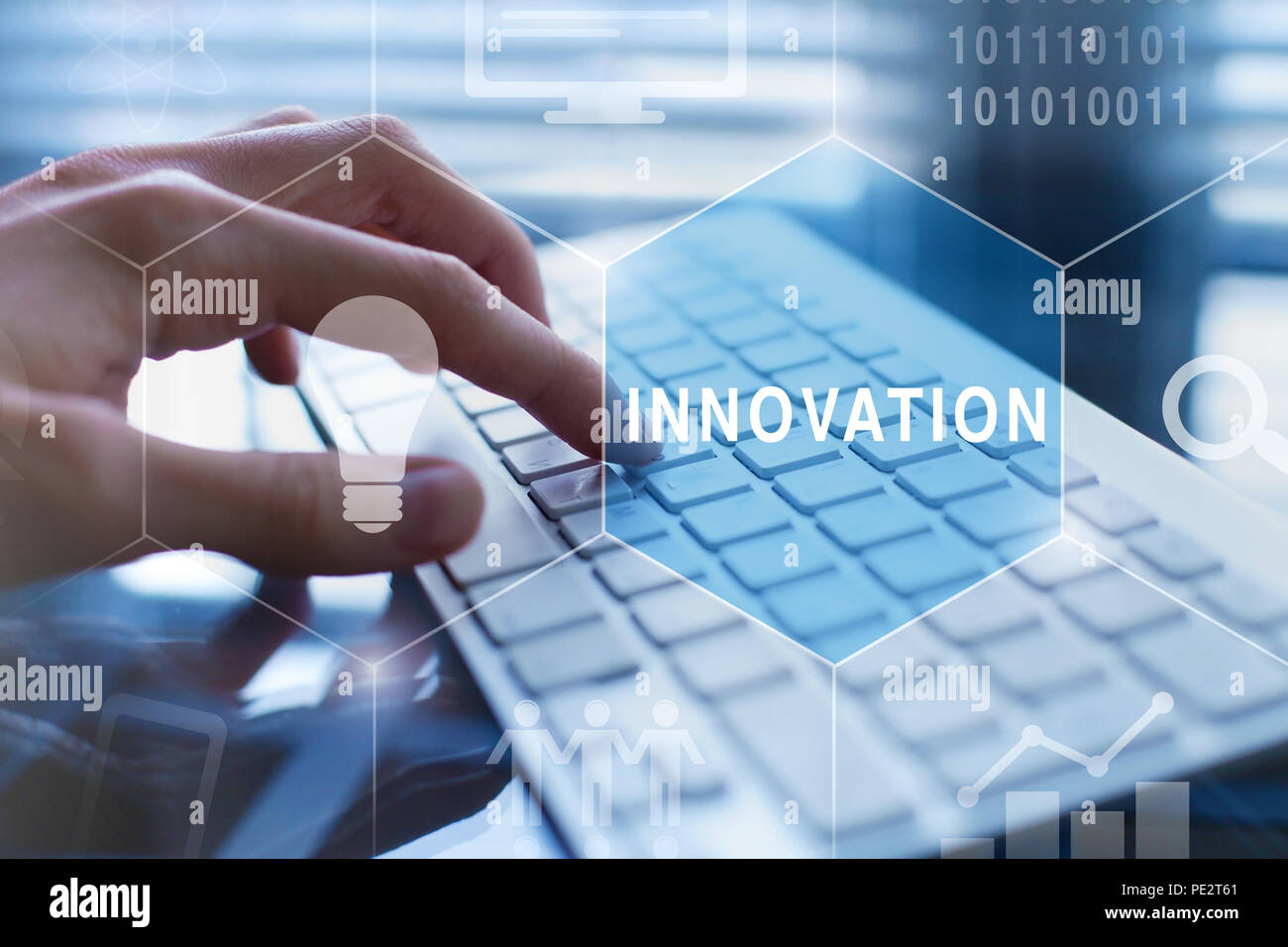 innovation concept, new digital technology, idea and development icons, hands typing on computer on background - Stock Image