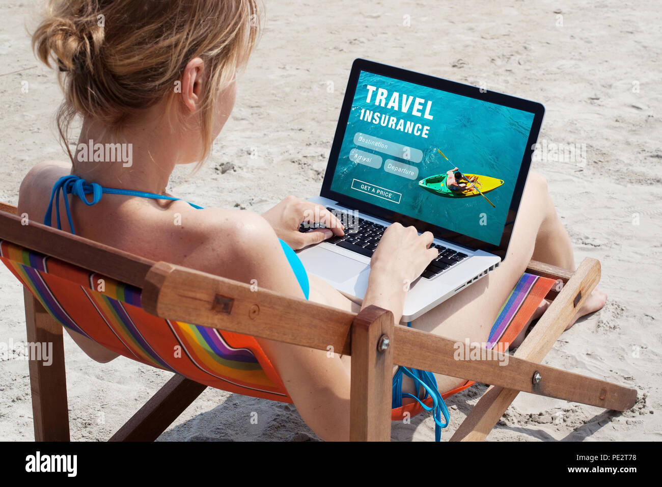 travel insurance online concept, tourist looking at the screen of computer Stock Photo