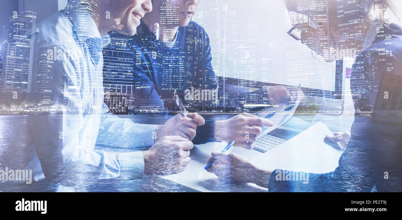 business team of coworkers working on startup in office, banner double exposure background of group of businessman people entrepreneurs - Stock Image