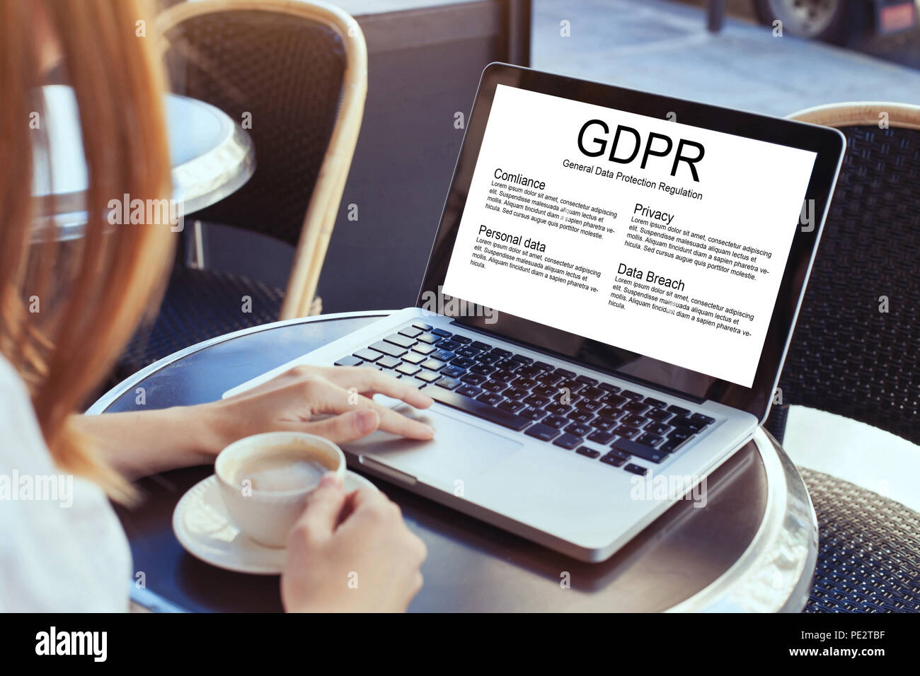 GDPR concept, woman reading about General Data Protection Regulation, private information - Stock Image