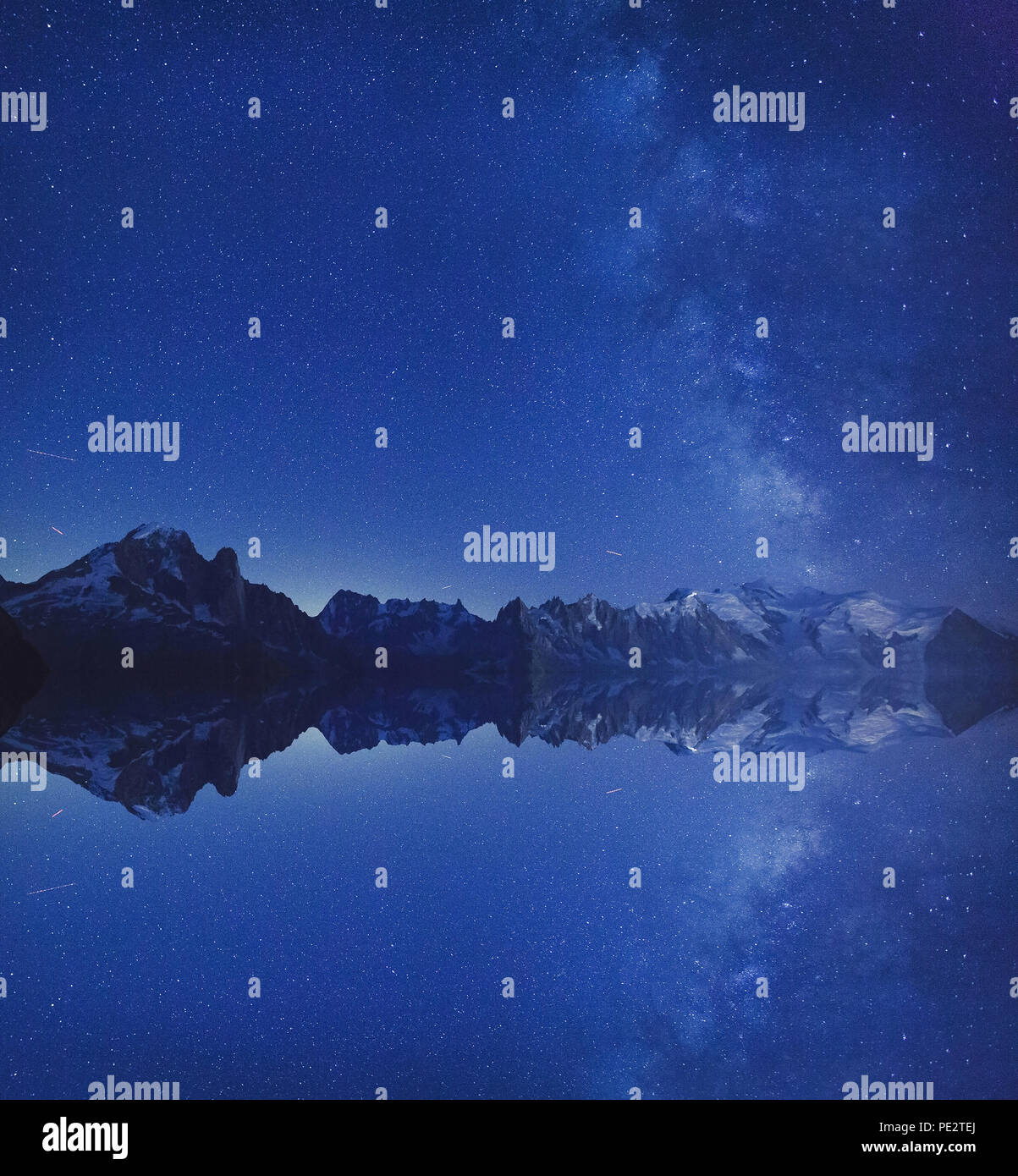 beautiful inspirational landscape, night stars and milky way over Alps mountains outdoor with reflection and copyspace, nature background - Stock Image