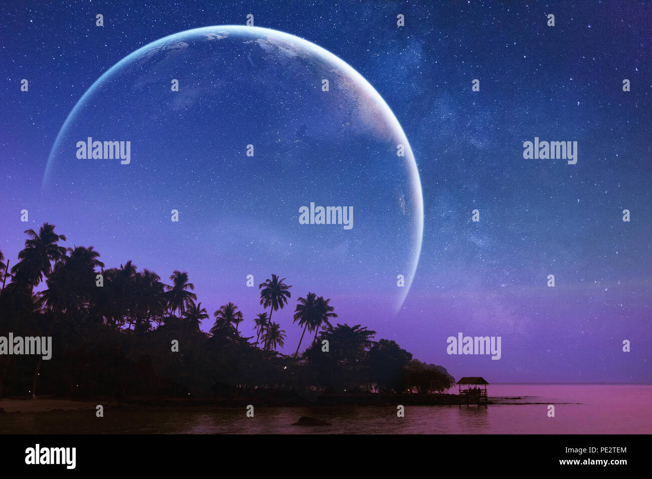 fantasy landscape, imaginary world, view of tropical wonderland with starry sky and big planet, dreamworld - Stock Image