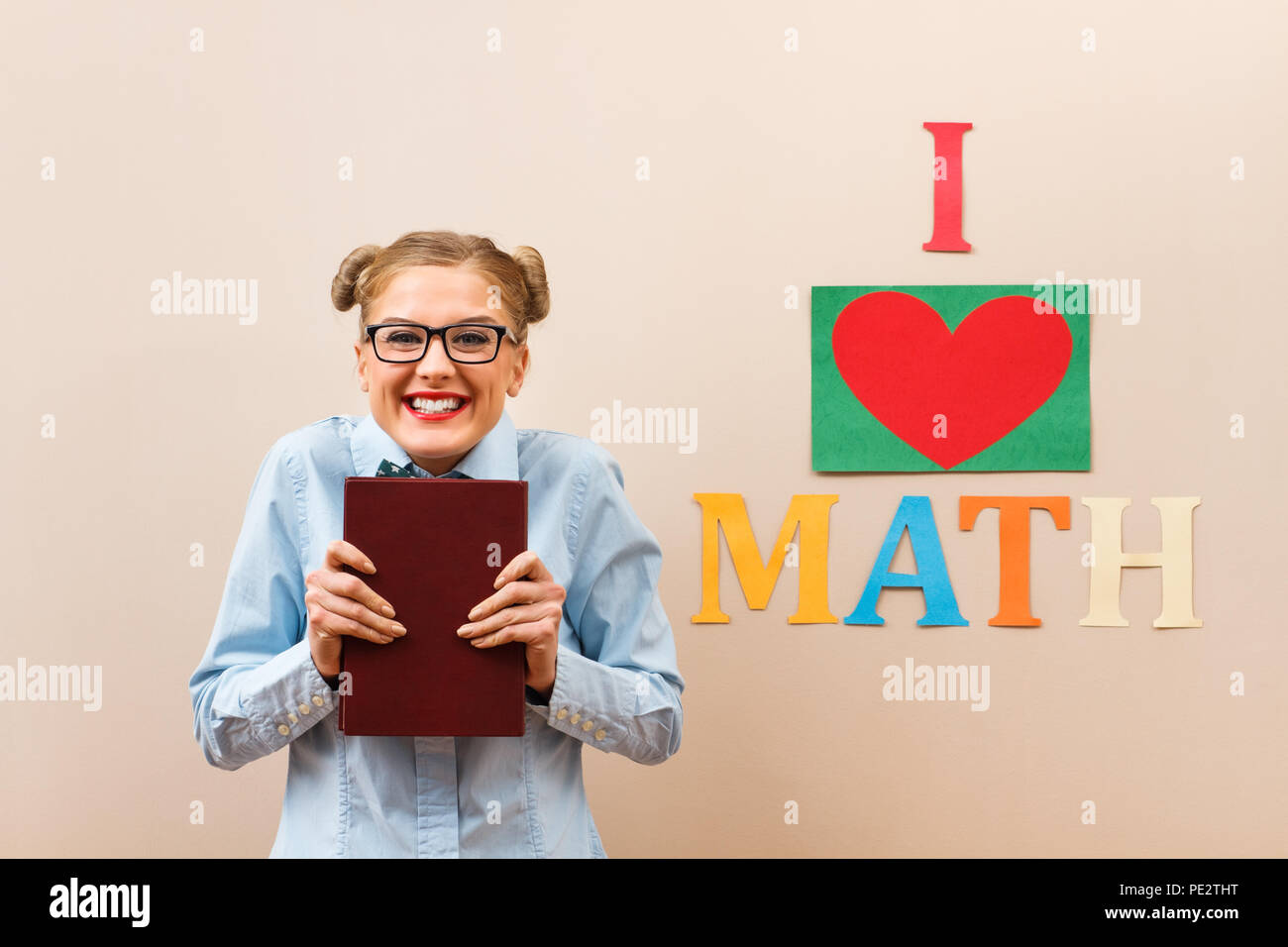 Happy nerdy woman loves math. - Stock Image