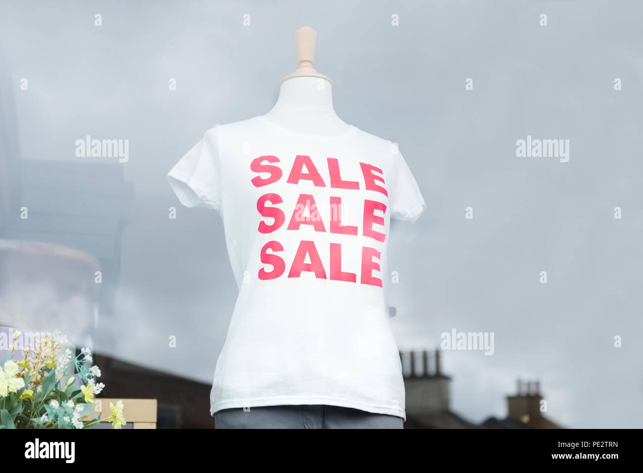 6a346ed6d Red sale white t-shirt on female mannequin in shop window Stock ...