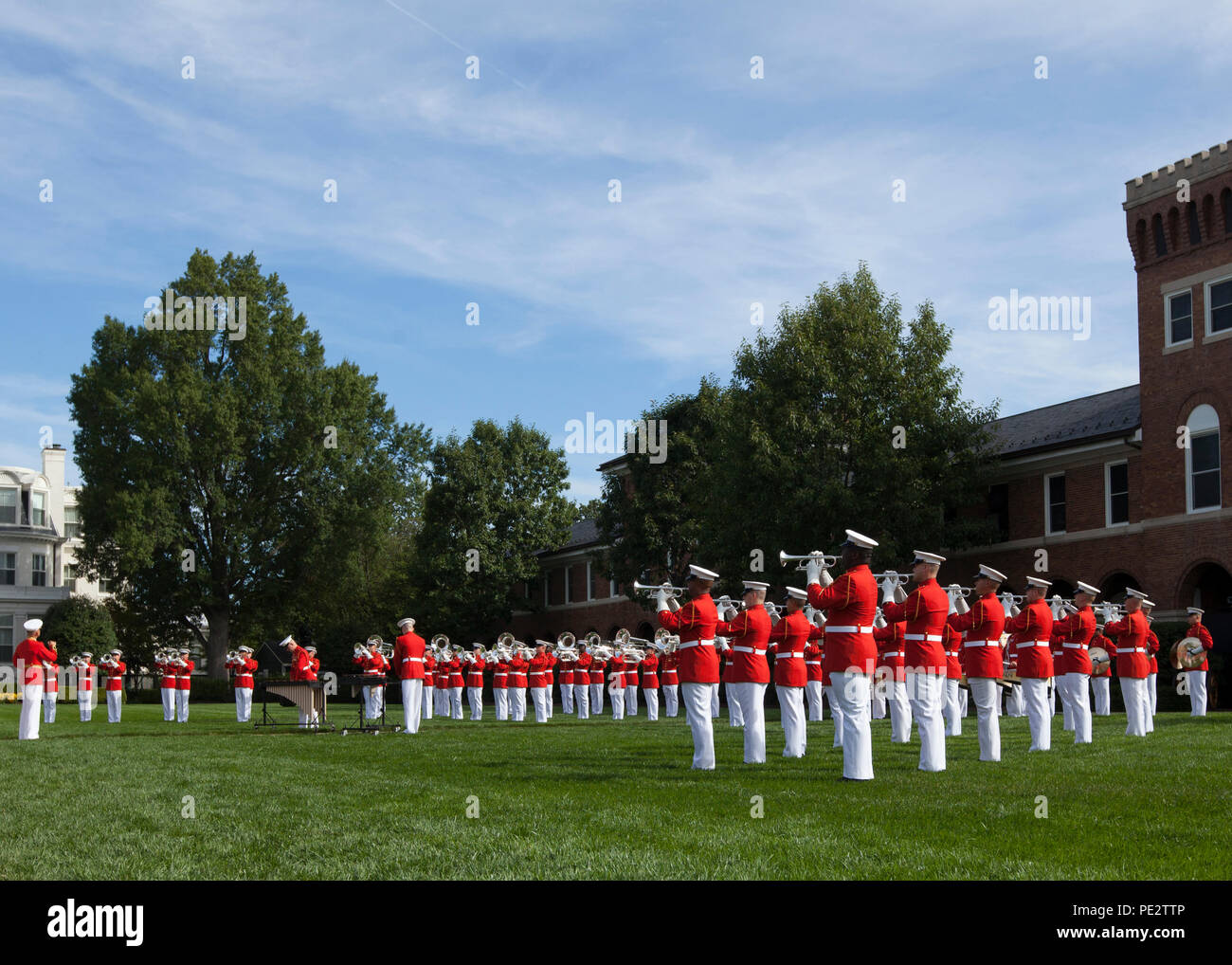 The U.S. Marine Corps Drum and Bugle Corps perform during a Passage of Command ceremony at Marine Barracks Washington, D.C., Sept. 24, 2015. Gen. Robert B. Neller took command from Gen. Joseph F. Dunford Jr. as the 37th Commandant of the Marine Corps. (U.S. Marine Corps photo by Lance Cpl. Christopher J. Nunn/Released) Stock Photo