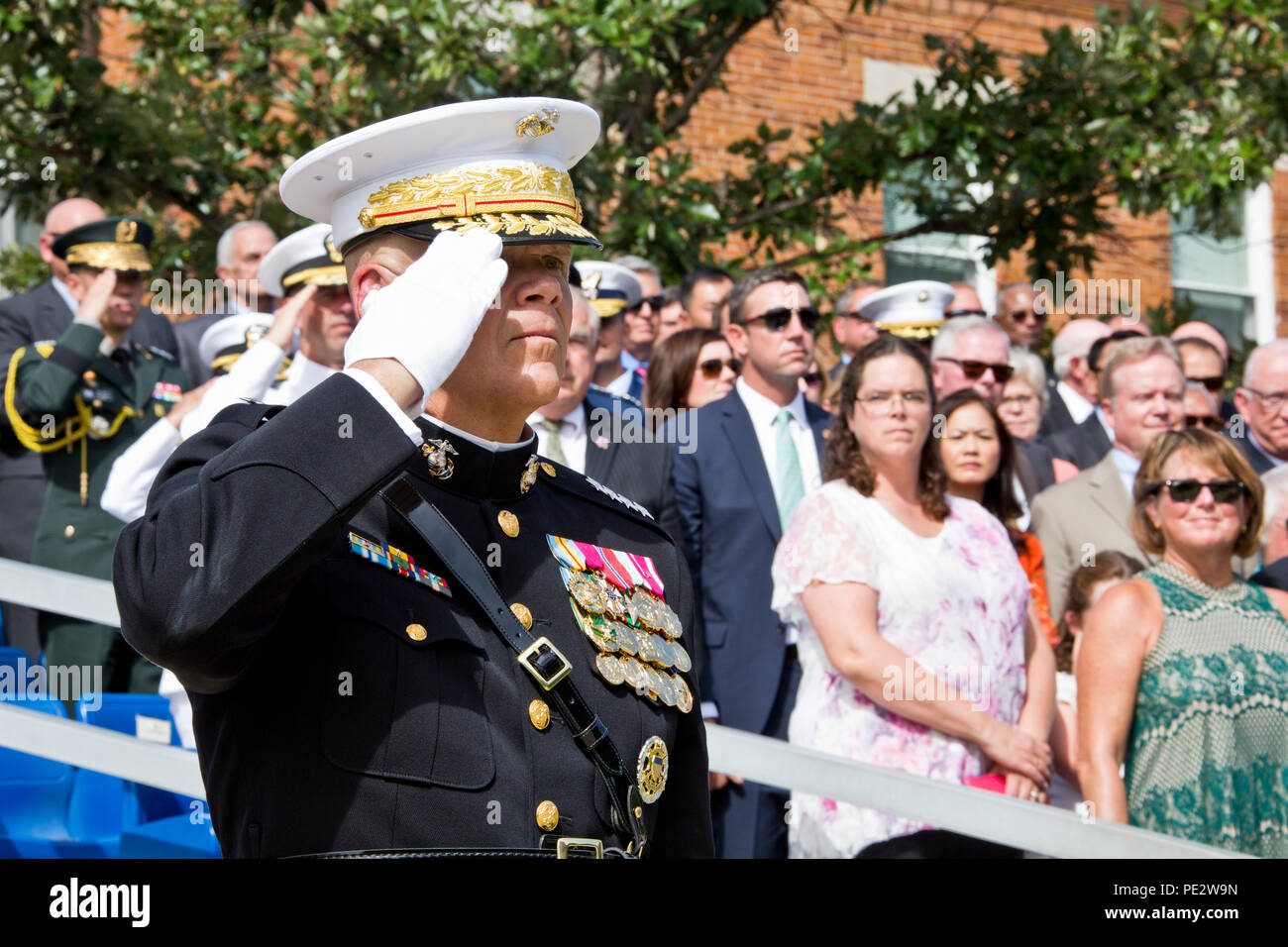 Commandant of the Marine Corps, Gen. Robert B. Neller, salutes during the Passage of Command at Marine Barracks Washington, D.C., Sept. 24, 2015. Neller took command from Gen. Joseph F. Dunford, Jr. as the 37th Commandant of the Marine Corps. (U.S. Marine Corps photo by Sgt. Gabriela Garcia/Released) Stock Photo