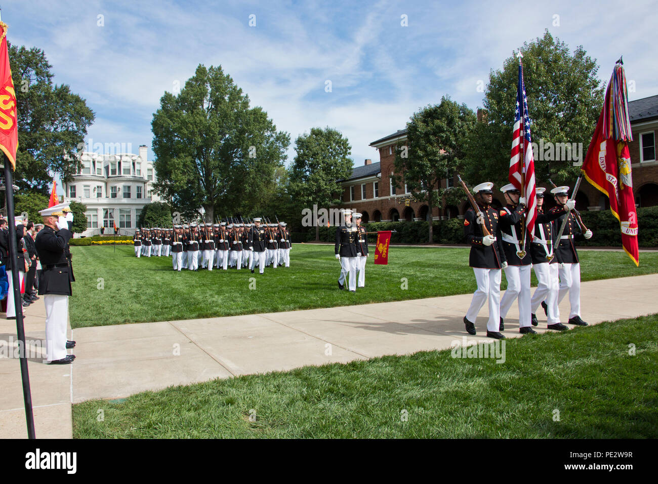 Commandant of the Marine Corps, Gen. Robert B. Neller and Gen. Joseph F. Dunford, Jr. salute the Marine Corps colors during the Passage of Command at Marine Barracks Washington, D.C., Sept. 24, 2015. Neller took command from Dunford as the 37th Commandant of the Marine Corps. (U.S. Marine Corps photo by Sgt. Gabriela Garcia/Released) Stock Photo