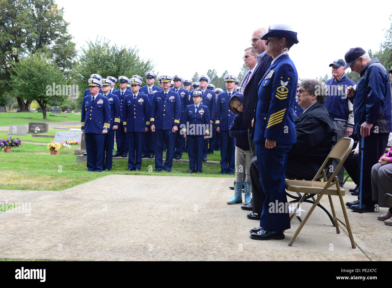 Master Chief Lani Cale-Jones, Deputy Master Chief Petty Officer of the Coast Guard, observes the Douglas Munro Memorial Ceremony at the Laurel Hills Memorial Cemetery in Cle Clum, Wash., Sept. 25, 2015. Rear Adm. Richard Gromlich, commander of the 13th Coast Guard District, spoke during the ceremony about Munro's bravery and devotion to duty. (U.S. Coast Guard photo by Petty Officer 3rd Class Katelyn Shearer) - Stock Image