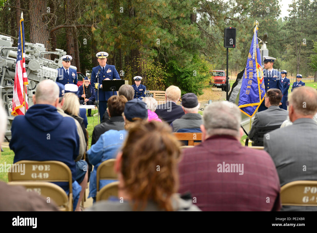 Rear Adm. Richard Gromlich, commander of the 13th Coast Guard District, addresses the crowd at the Douglas Munro Memorial Ceremony at the Laurel Hills Memorial Cemetery in Cle Clum, Wash., Sept. 25, 2015. Attendees included the mayors of Cle Elum, South Cle Elum and Roslyn; family members of Douglas Munro, former Master Chief Petty Officers of the Coast Guard, and the current Deputy Master Chief Petty Officer of the Coast Guard. (U.S. Coast Guard photo by Petty Officer 3rd Class Katelyn Shearer) - Stock Image