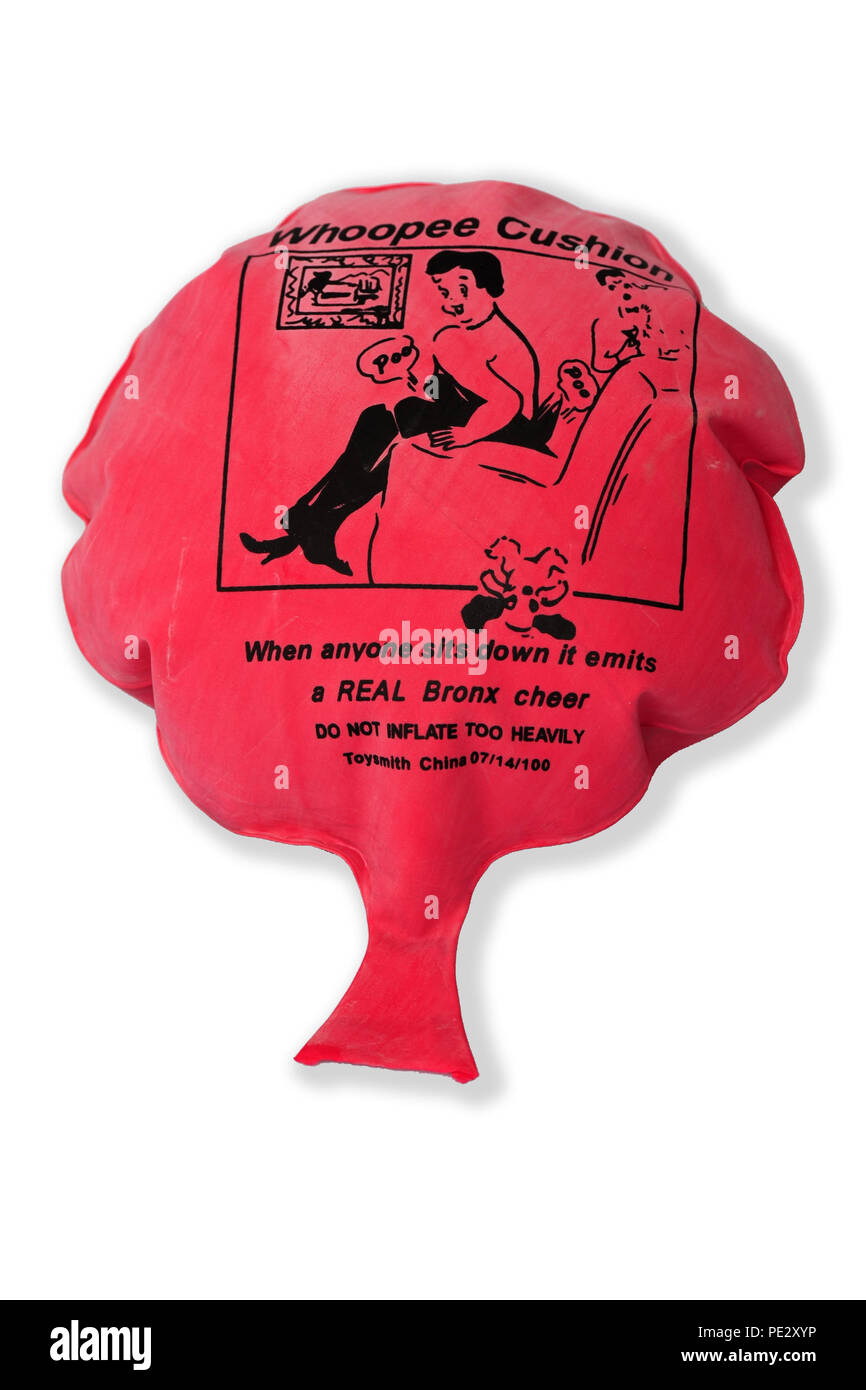 a red novelty Whoopee Cushion made for gags and tricks for fake fart noises - Stock Image