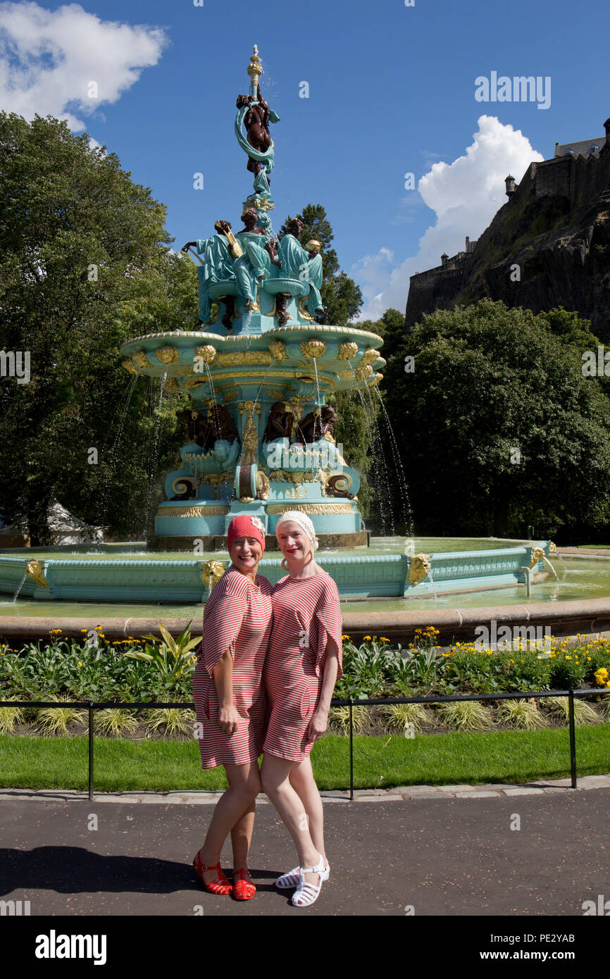 A Splashmob from Dancebase in Edinburgh entertain tourists at the refurbished Ross Fountain in Princes Street Gardens, Edinburgh, Scotland - Stock Image