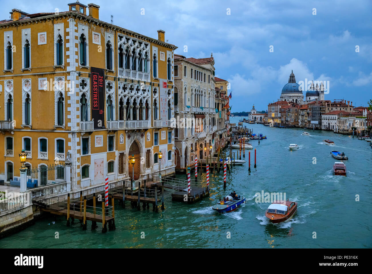 Venice, Italy - September 24, 2017: Sunset at the iconic 17th-century Santa Maria di Salute Basilica, view from Academia bridge or Puente de la academ Stock Photo