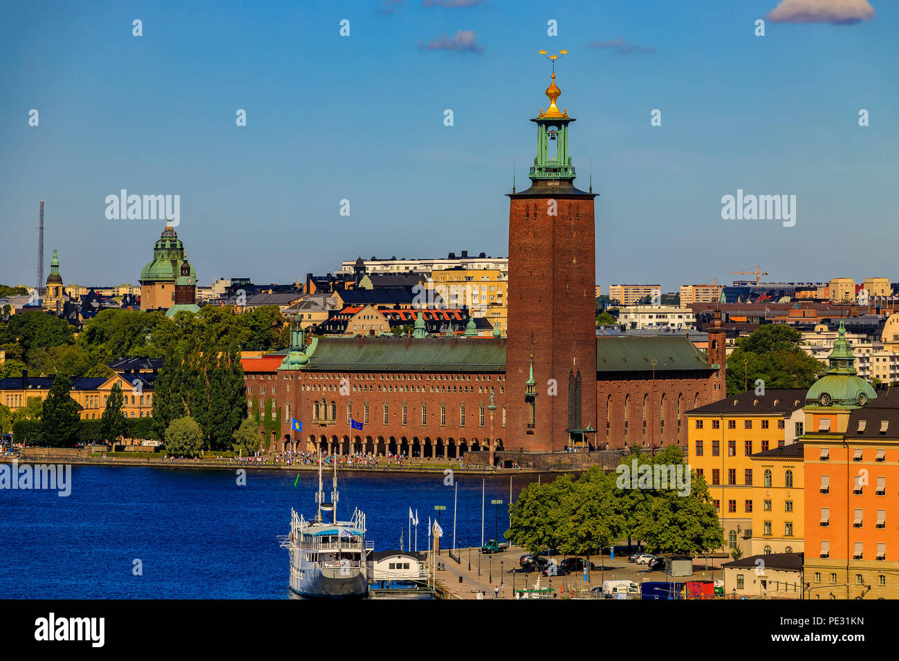 Stockholm, Sweden - August 11, 2017: View onto City Hall, Stadshuset, in Kungsholmen island and traditional gothic buildings in old town - Stock Image