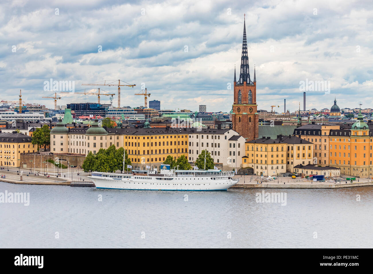 Stockholm, Sweden - August 10, 2017:  View onto Riddarholmen island and Riddarholmen church, the burial church of Swedish monarchs, in old town Gamla  - Stock Image
