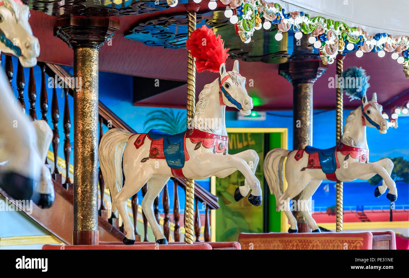 Nice, France - May 27, 2017: Colorful decor of the high end restaurant La Rotonde inside the famous hotel Negresco with the horses of a carousel - Stock Image