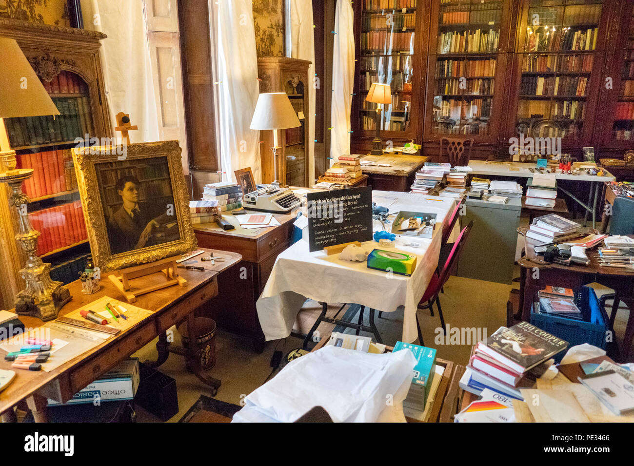 UK, Wales, Anglesey, Plas Newydd House, Henry's study during conservation - Stock Image