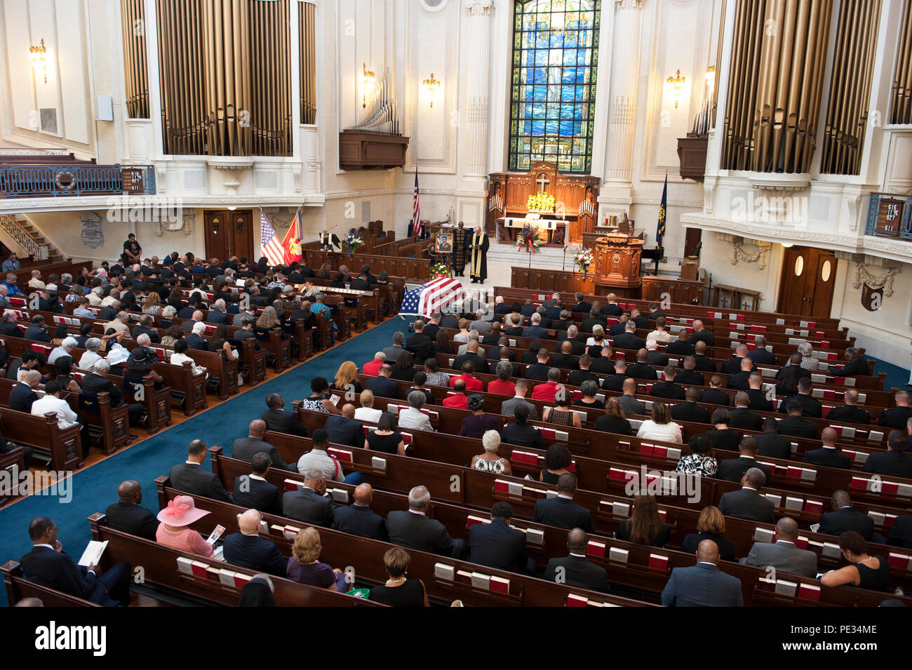 Retired United States Navy Rear Admiral Barry C. Black, 62nd Chaplain of the U.S. Senate, left, and Capt. Michael Gore, chaplain USN, recite the benediction at the memorial service of retired Lt. Gen. Frank E. Petersen Jr. at the U.S. Naval Academy Chapel, Annapolis, Md., Sept. 3, 2015. Petersen, the first African-American Marine Corps Aviator and General in history, passed away Aug. 25, 2015. (U.S. Marine Corps photo by Monique R. LaRouche/Released) - Stock Image